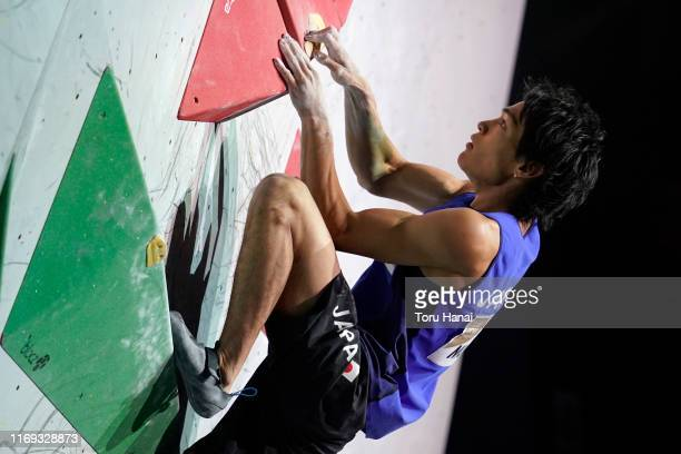 Tomoa Narasaki of Japan compes in the Bouldering during Combined Men's Final on day eleven of the IFSC Climbing World Championships at the Esforta...