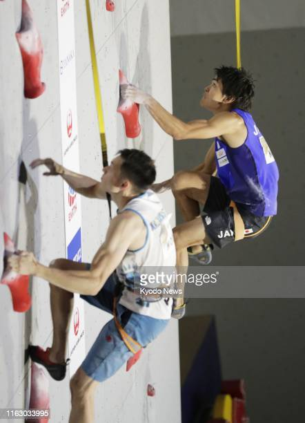 Tomoa Narasaki of Japan competes en route to placing second in the speed discipline of the men's combined final at the sport climbing world...