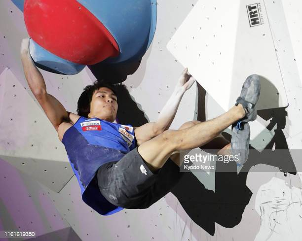 Tomoa Narasaki of Japan competes en route to winning the men's bouldering at the climbing world championships in Hachioji, Tokyo, on Aug. 13, 2019....