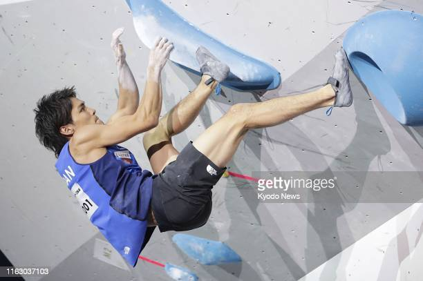 Tomoa Narasaki of Japan competes in the bouldering discipline of the men's combined final at the sport climbing world championships in Hachioji Tokyo...