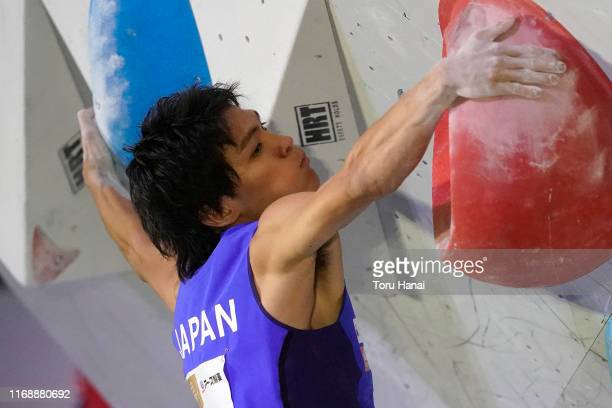 Tomoa Narasaki of Japan competes in the Bouldering during Combined Men's Qualification on day nine of the IFSC Climbing World Championships at the...