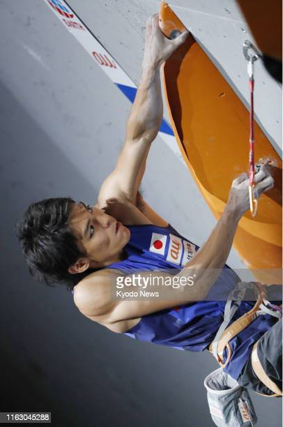 Tomoa Narasaki of Japan competes in the lead discipline of the men's combined final at the sport climbing world championships in Hachioji western...