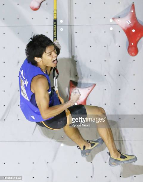 Tomoa Narasaki of Japan reacts after competing in the speed discipline of the men's combined final at the sport climbing world championships in...