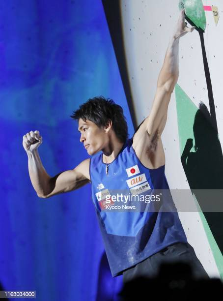 Tomoa Narasaki of Japan reacts after completing the first problem in the bouldering discipline of the men's combined final at the sport climbing...
