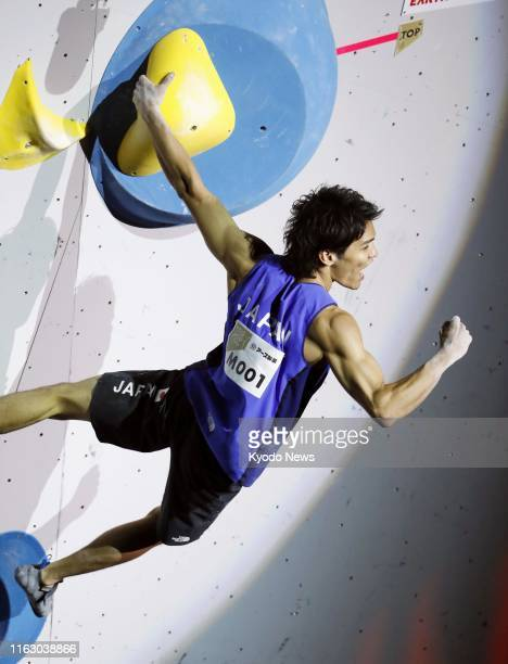 Tomoa Narasaki of Japan reacts after completing the second problem in the bouldering discipline of the men's combined final at the sport climbing...