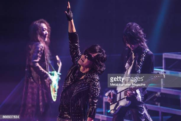 Tomoaki Ishizuka Toshimitsu Deyama and Hiroshi Morie of Japanese glam metal group X Japan performing live on stage at the SSE Wembley Arena in London...