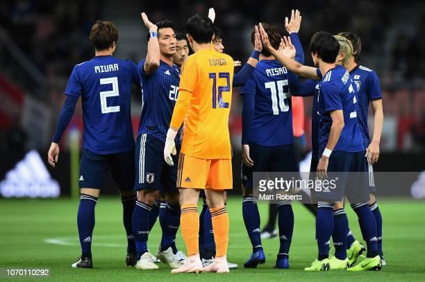 Tomoaki Makino and Shuichi Gonda of Japan high five prior to the international friendly match bewteen Japan and Kyrgyz at Toyota Stadium on November...
