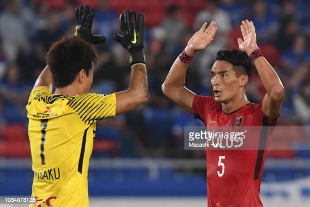 Tomoaki Makino and Shusaku Nishikawa of Urawa Red Diamonds celebrate the win during the JLeague J1 match between Yokohama FMarinos and Urawa Red...