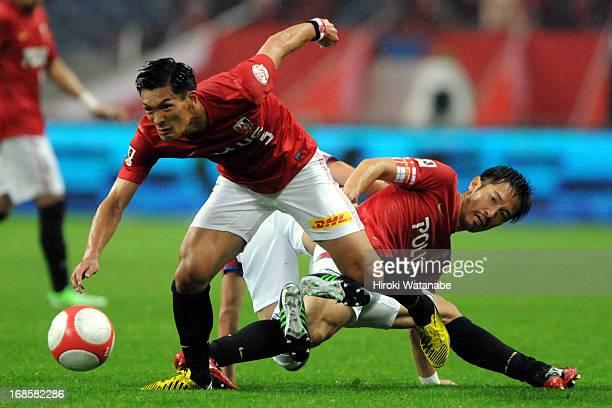 Tomoaki Makino and Yuki Abe of Urawa Red Diamonds in action during the JLeague match between Urawa Red Diamonds and Kashima Antlers at Saitama...