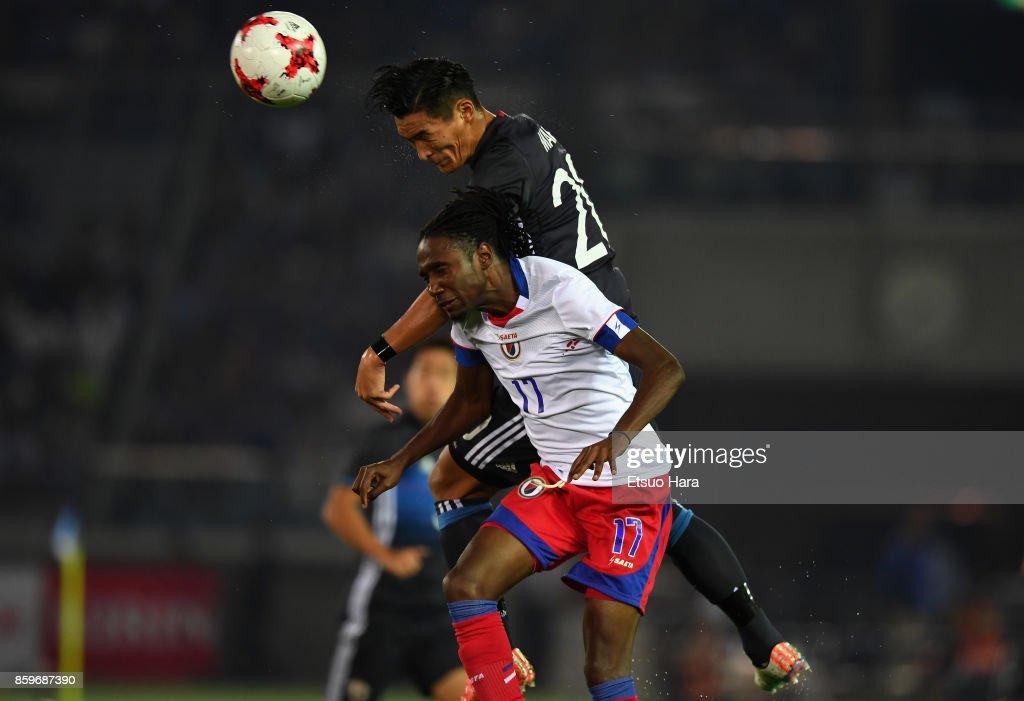Tomoaki Makino of Japan and Jimmy-Shammar Sanon of Haiti compete for the ball during the international friendly match between Japan and Haiti at Nissan Stadium on October 10, 2017 in Yokohama, Kanagawa, Japan.