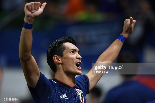 Tomoaki Makino of Japan applauds fans after the international friendly match between Japan and Costa Rica at Suita City Football Stadium on September...
