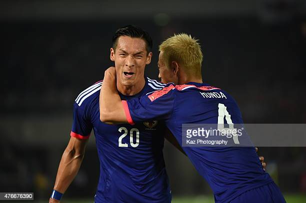 Tomoaki Makino of Japan celebrates Japan's 2nd goal with Keisuke Honda of Japan during the international friendly match between Japan and Iraq at...