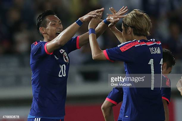 Tomoaki Makino of Japan celebrates scoring a goal with team mate Takashi Usami during the international friendly match between Japan and Iraq at...