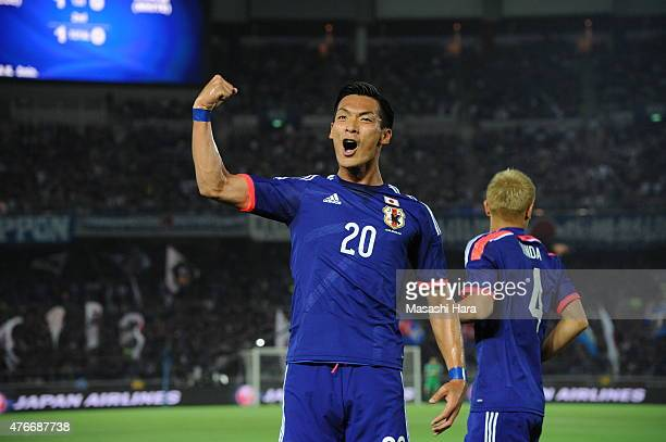 Tomoaki Makino of Japan celebrates the second goal during the international friendly match between Japan and Iraq at Nissan Stadium on June 11 2015...