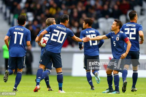 Tomoaki Makino of Japan celebrates with team mates after scoring his sides first goal during the international friendly match between Brazil and...