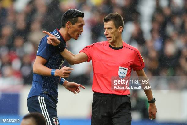 Tomoaki Makino of Japan has a disagreement with Referee Benoit Bastien after a penalty is awarded during the international friendly match between...
