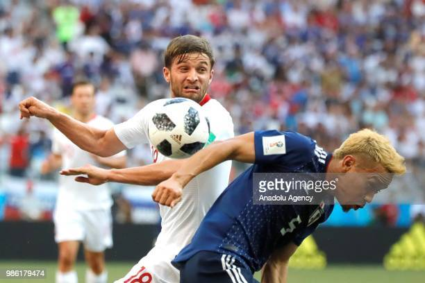 Tomoaki Makino of Japan in action against Bartosz Bereszynski of Poland during the 2018 FIFA World Cup Russia Group H match between Japan and Poland...