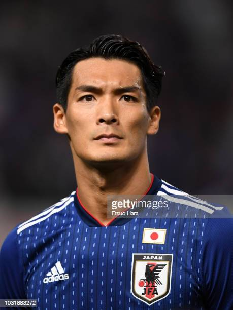 Tomoaki Makino of Japan looks on prior to the international friendly match between Japan and Costa Rica at Suita City Football Stadium on September...