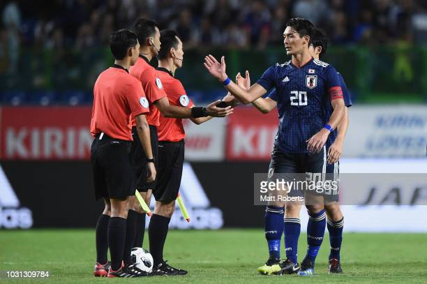 Tomoaki Makino of Japan shakes hands with the referee during the international friendly match between Japan and Costa Rica at Suita City Football...