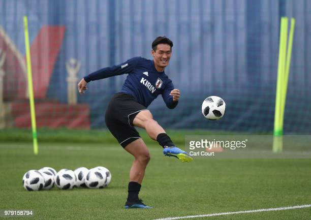 Kosuke Nakamura of Japan passes the ball during a Japan training session during the 2018 FIFA World Cup at the FC Rubin Training Ground on June 20...
