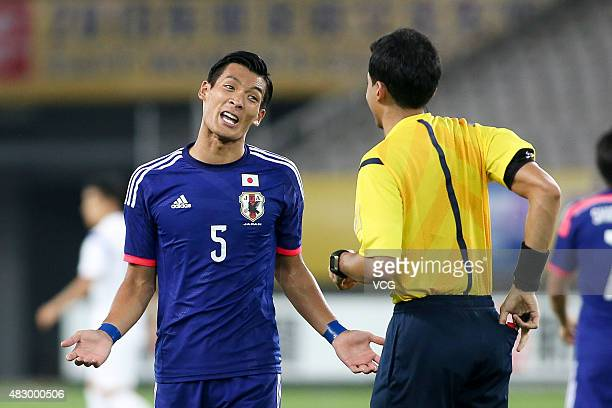 Tomoaki Makino of Japan talks to the judge in group match between Japan and South Korea during EAFF East Asian Cup 2015 at Wuhan Sports Center...