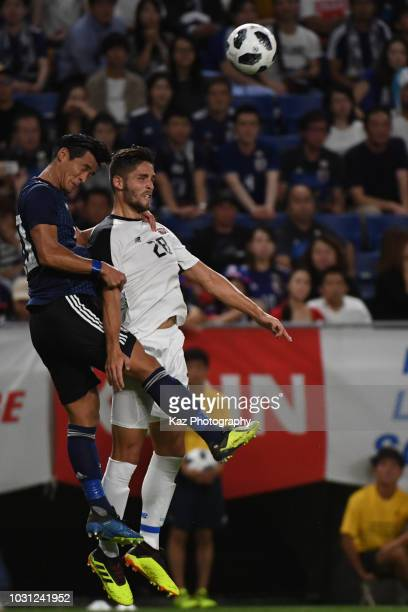 Tomoaki Makino of Japan wins the header over Jonathan Moya of Costa Rica during the international friendly match between Japan and Costa Rica at...