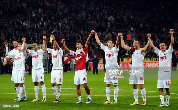 Tomoaki Makino of Koeln celebrates with team mates after winning the Bundesliga match between 1 FC Koeln and FC Augsburg at RheinEnergieStadion on...