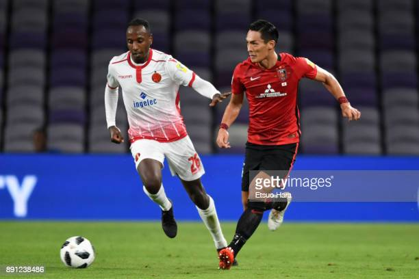 Tomoaki Makino of Urawa Red Diamonds and Abdeladim Khadrouf of Wydad Casablanca compete for the ball during the FIFA Club World Cup UAE 2017 Match...