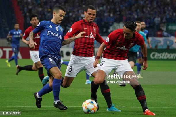 Tomoaki Makino of Urawa Red Diamonds and Ewerton of Urawa Red Diamonds and Sebastian Giovinco of Al Hilal compete for the ball during the AFC...