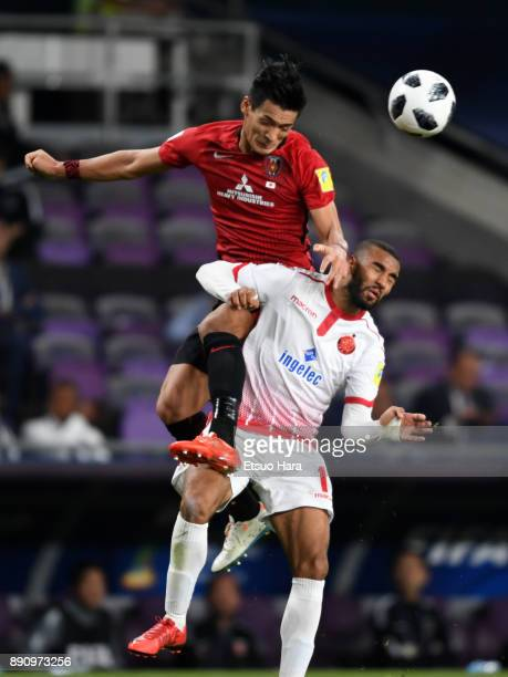 Tomoaki Makino of Urawa Red Diamonds and Ismail El Haddad of Wydad Casablanca compete for the ball during the FIFA Club World Cup UAE 2017 Match for...