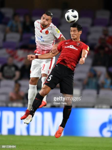 Tomoaki Makino of Urawa Red Diamonds and Mohamed Aoulad Youssef of Wydad Casablanca compete for the ball during the FIFA Club World Cup UAE 2017...