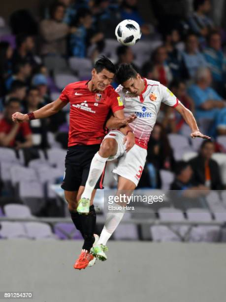 Tomoaki Makino of Urawa Red Diamonds and Mohammed Nahiri of Wydad Casablanca compete for the ball during the FIFA Club World Cup UAE 2017 Match for...
