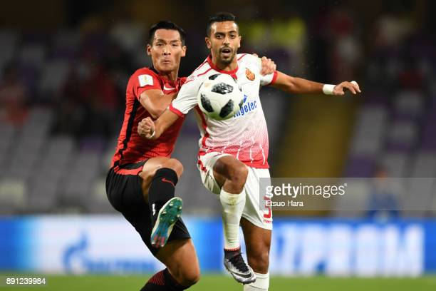 Tomoaki Makino of Urawa Red Diamonds and Reda Hajhouj of Wydad Casablanca compete for the ball during the FIFA Club World Cup UAE 2017 Match for 5th...