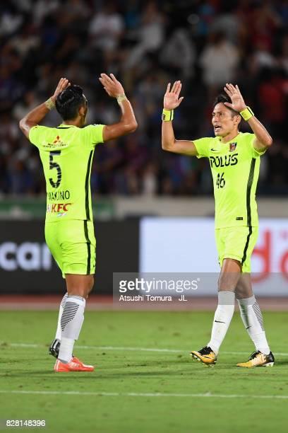 Tomoaki Makino of Urawa Red Diamonds and Ryota Moriwaki Urawa Red Diamonds celebrate their 10 win after the JLeague J1 match between Ventforet Kofu...