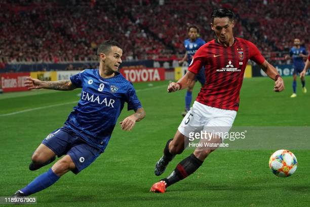 Tomoaki Makino of Urawa Red Diamonds and Sebastian Giovinco of Al Hilal compete for the ball during the AFC Champions League Final second leg match...
