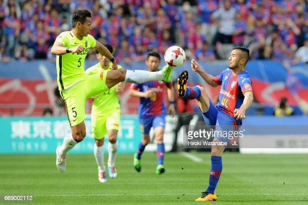 Tomoaki Makino of Urawa Red Diamonds and Takuma Abe of FC Tokyo compete for the ball during the J.League J1 match between FC Tokyo and Urawa Red...