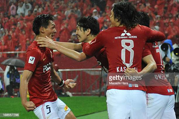 Tomoaki Makino of Urawa Red Diamonds and team-mates celebrate their team's first goal during the J.League match between Urawa Red Diamonds and...