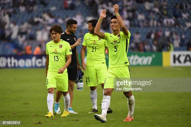 Tomoaki Makino of Urawa Red Diamonds applauds away supporters after the 11 draw in the AFC Champions League Final 2017 first leg between AlHilal and...