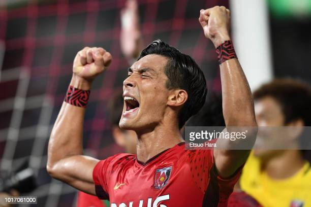 Tomoaki Makino of Urawa Red Diamonds celebrates his side's 40 victory after the JLeague J1 match between Urawa Red Diamonds and Jubilo Iwata at...