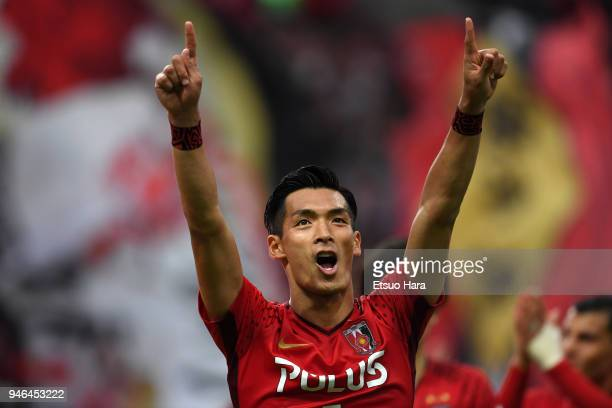 Tomoaki Makino of Urawa Red Diamonds celebrates his side's victory after the J.League J1 match between Urawa Red Diamonds and Shimizu S-Pulse at...