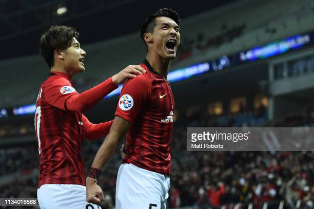 Tomoaki Makino of Urawa Red Diamonds celebrates scoring a goal during the AFC Champions League Group G match between Urawa Red Diamonds and Buriram...
