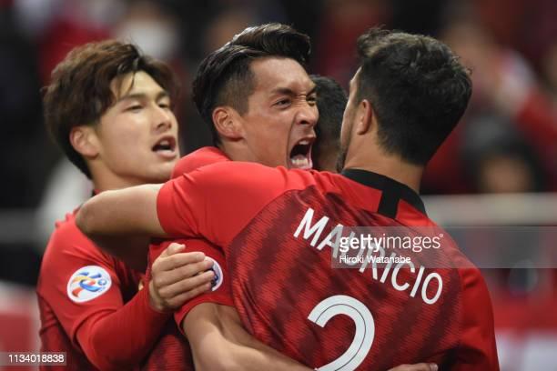 Tomoaki Makino of Urawa Red Diamonds celebrates scoring his team's first goal during the AFC Champions League Group G match between Urawa Red...