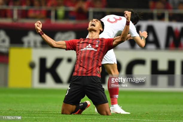Tomoaki Makino of Urawa Red Diamonds celebrates the victory at the end of the AFC Champions League quarter final second leg match between Urawa Red...