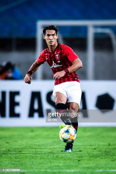 Tomoaki Makino of Urawa Red Diamonds controls the ball during the AFC Champions League Group G match between Beijing Guoan and Urawa Red Diamonds at...