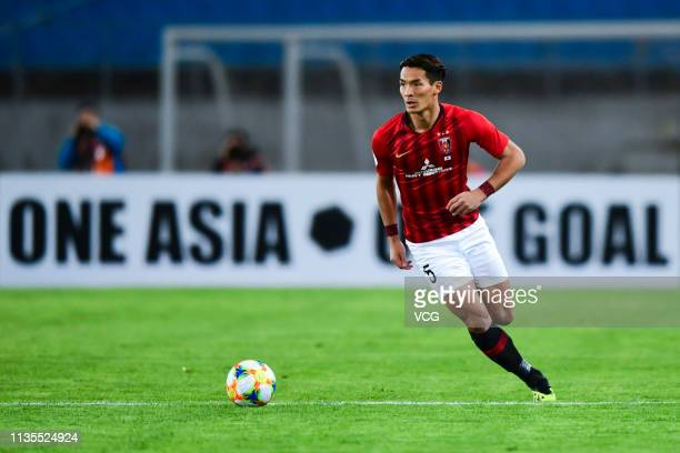 Tomoaki Makino of Urawa Red Diamonds drives the ball during the 2019 AFC Champions League Group G match between Beijing Guoan and Urawa Red Diamonds...