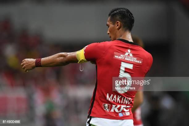 Tomoaki Makino of Urawa Red Diamonds holds the armband of captain during the preseason friendly match between Urawa Red Diamonds and Borussia...