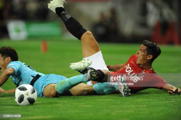 Tomoaki Makino of Urawa Red Diamonds in action during the JLeague J1 match between Urawa Red Diamonds and Vissel Kobe at Saitama Stadium on September...