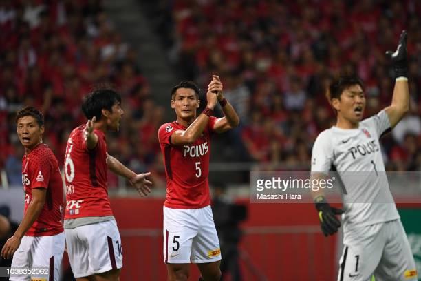 Tomoaki Makino of Urawa Red Diamonds looks on during the JLeague J1 match between Urawa Red Diamonds and Vissel Kobe at Saitama Stadium on September...