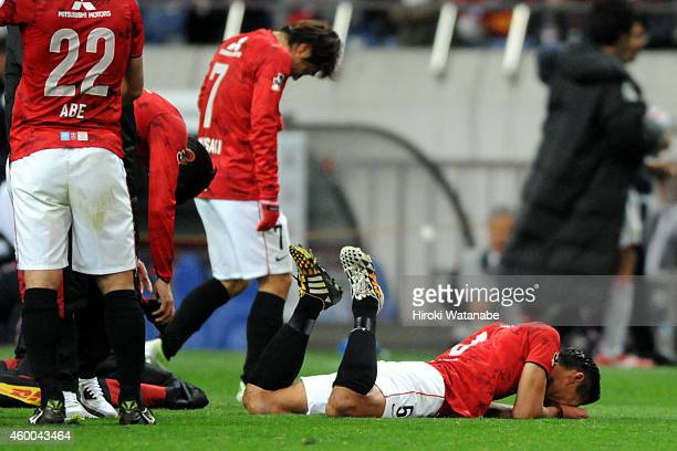 Tomoaki Makino of Urawa Red Diamonds reacts after the 12 defeat in the JLeague match between Urawa Red Diamonds and Nagoya Grampus at Saitama Stadium...