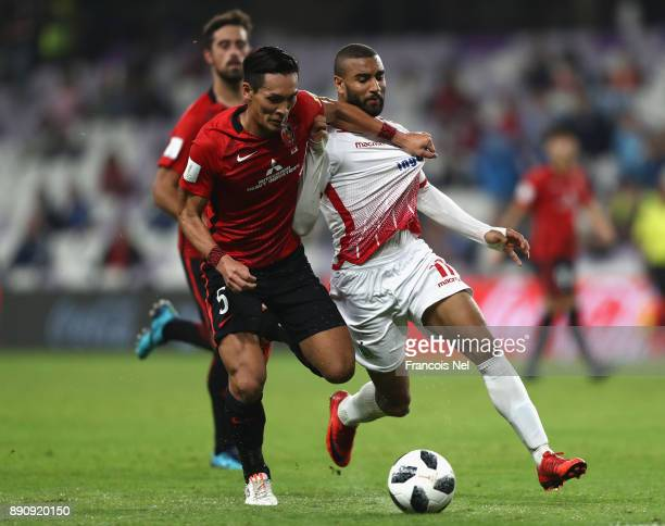 Tomoaki Makino of Urawa Reds and Ismail El Haddad of Wydad Casablanca in action during the FIFA Club World Cup UAE 2017 fifth place playoff match...